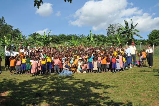 Schoolchildren in Uganda show their appreciation for the visit from Lacey residents.