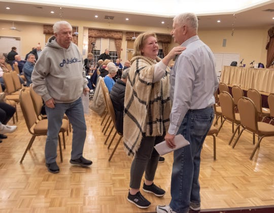 Rob Robison (far right) is greeted by fellow residents Dianne and Martin Burkhardt  prior to a Nov. 19, 2018 community meeting in the Fairways at Lake Ridge development.