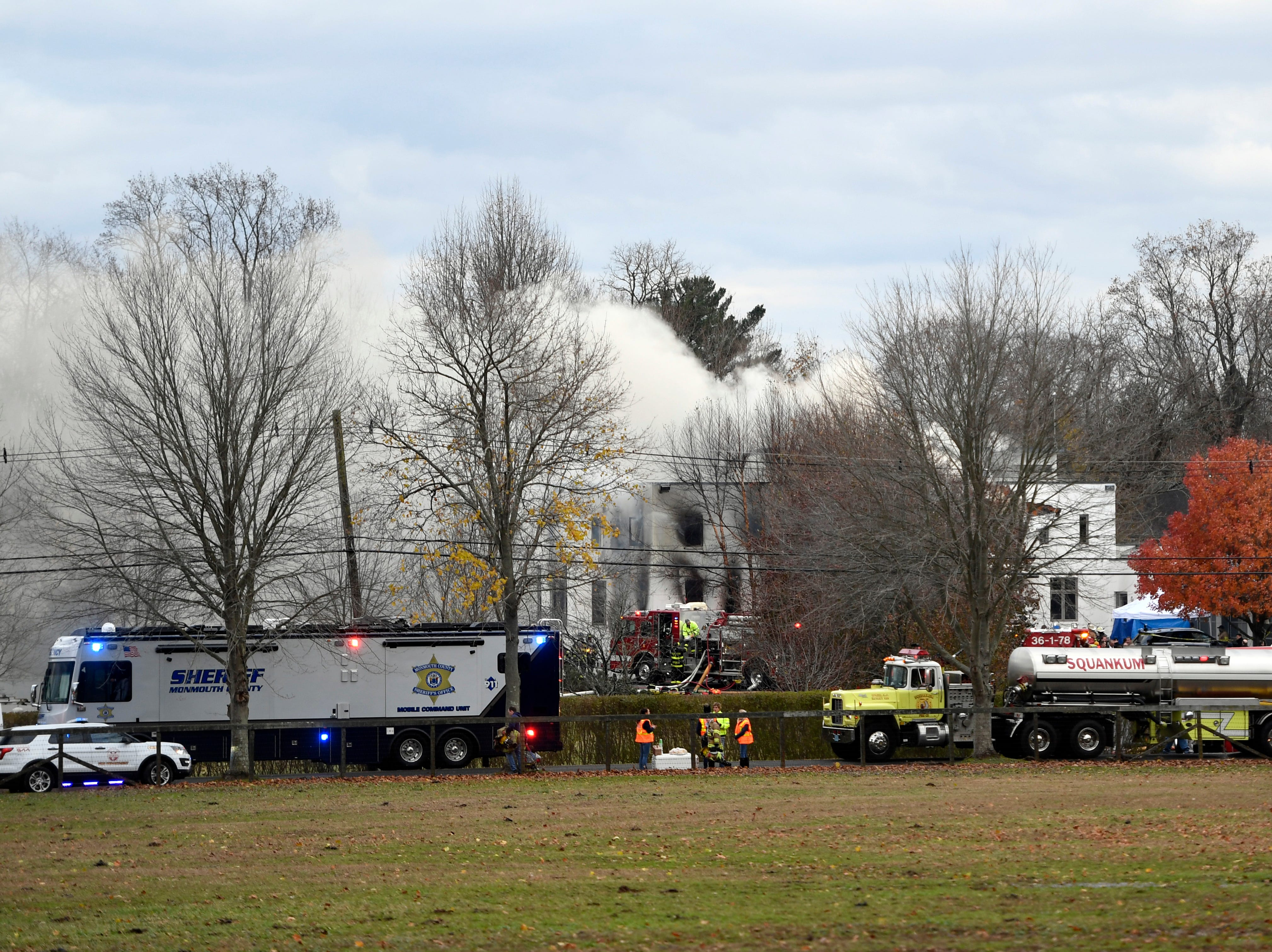 Colts Neck firefighters respond to a house fire off of Willow Brook Road on Tuesday, Nov. 20, 2018, in Colts Neck.