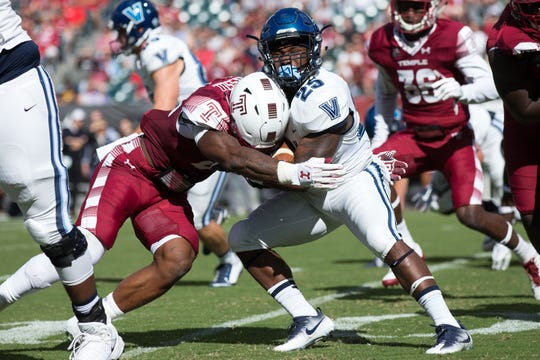 Temple Owls linebacker Chapelle Russell (22) tackles Villanova Wildcats running back Aaron Forbes (25) in 2017