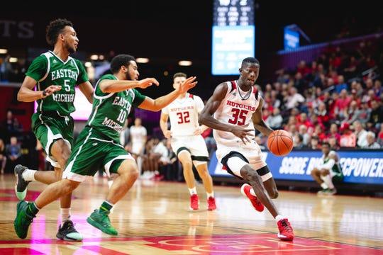 Rutgers' Issa Thiam drives against Eastern Michigan. Thiam had six assists.