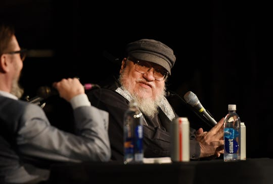 "New Jersey native George R.R. Martin (R), the author of ""Game of Thrones"" talks with John Hodgman, comedian and author, at the Loew's Jersey Theatre in Jersey City on 11/19/18."