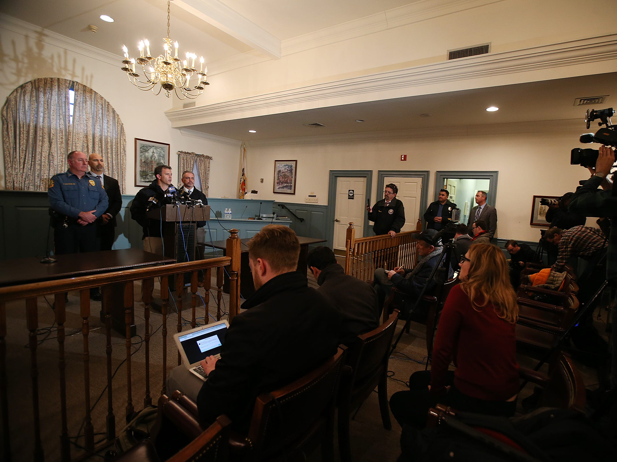 Monmouth County Prosecutor Christopher Gramiccioni holds a press conference to confirm four fatalities involved in the Colts Neck fire at 15 Willow Brook Road in Colts Neck, NJ Tuesday November 20, 2018. Behind him stand (L-R) Colts Neck Acting Police Chief Frank Leccese, Colts Neck Mayor JP Bartolomeo and Monmouth County Chief of Detectives John G. McCabe, Jr.