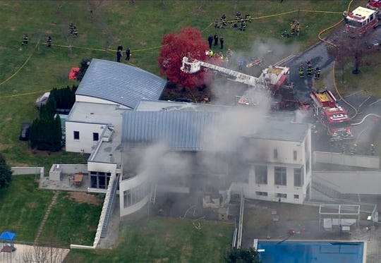 Emergency personnel surround the multi-fatal fire scene at 15 Willow Brook Road in Colts Neck on Tuesday, November 20, 2018.
