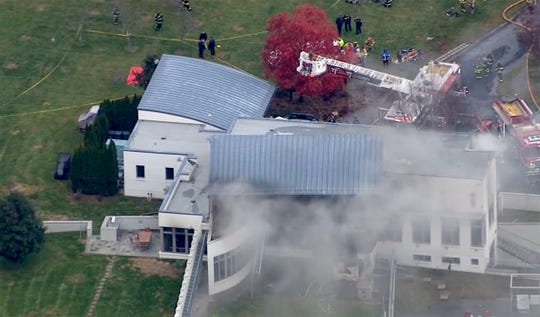 Emergency personnel surround the scene of a multi-fatal fire at 15 Willow Brook Road in Colts Neck Tuesday, November 20, 2018.
