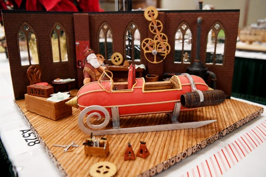 "The grand prize of the Omni Grove Park Inn's National Gingerbread House Competition, ""Gearing up for Christmas,"" created by Julie and Michael Andreacola, of Indian Trail."