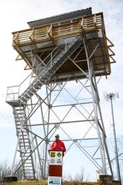 Peter Barr, coordinator of the North Carolina chapter of the Forest Fire Lookout Association, speaks at a ribbon cutting ceremony at the Rich Mountain lookout tower near Hot Springs Nov. 19, 2018.