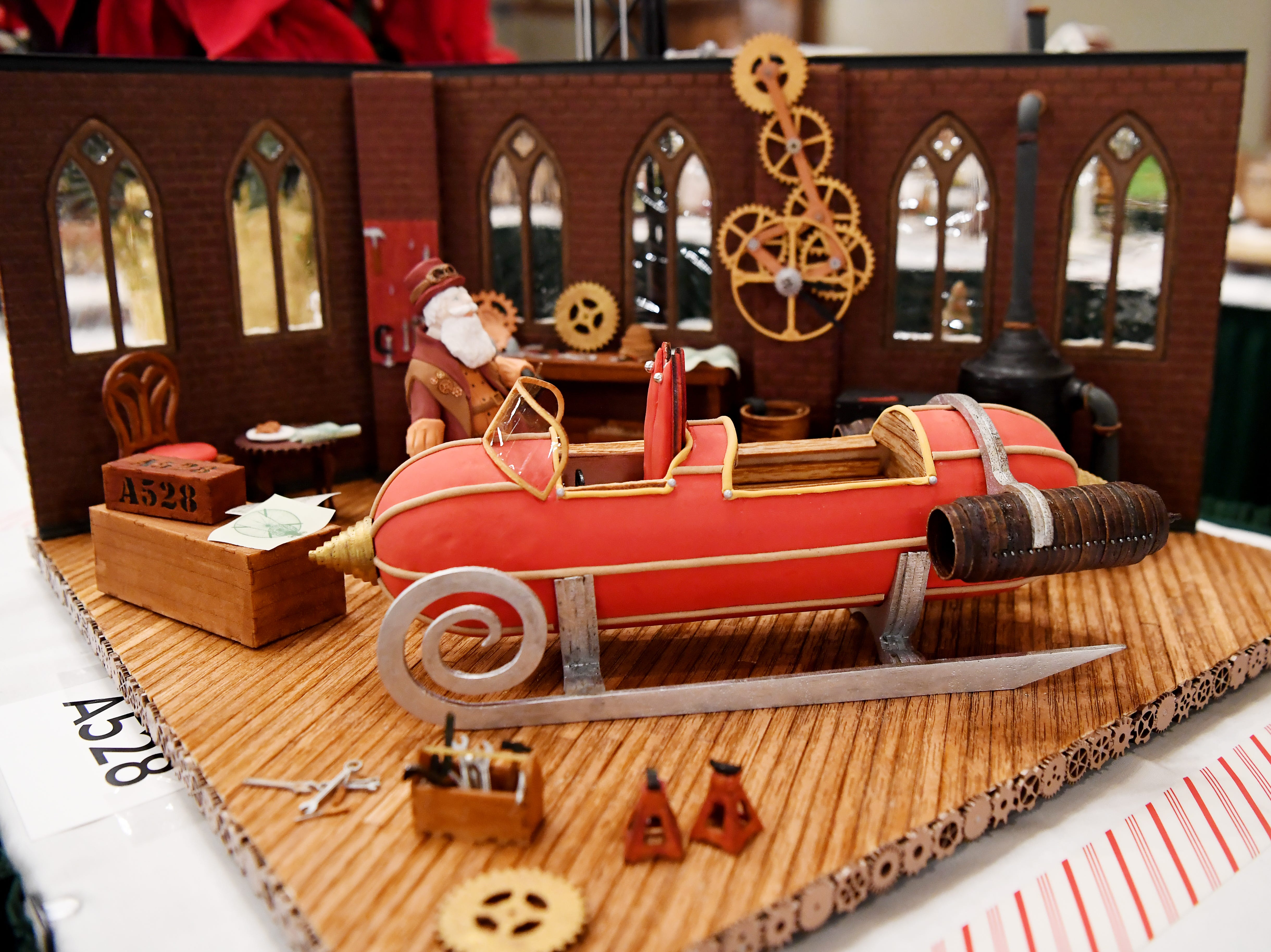 """The grand prize of the Omni Grove Park Inn's National Gingerbread House Competition, """"Gearing up for Christmas,"""" created by Julie and Michael Andreacola, of Indian Trail."""