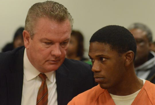 Davion Brown listens to his attorney, Donald Sappanos.