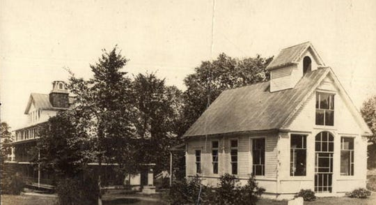 The spring house of the sanitarium is seen on the right in this postcard.