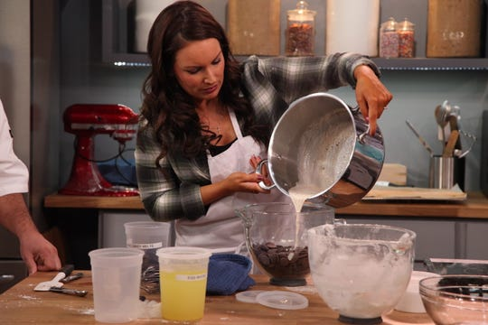 """Monique Chavez  pours batter into a bowl with candy pieces on """"Bake it Like Buddy."""""""