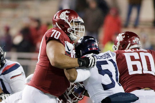 Christian Haangana (70) and other members of the Washington State offensive line are among the reasons the Cougars offense is especially potent this season.
