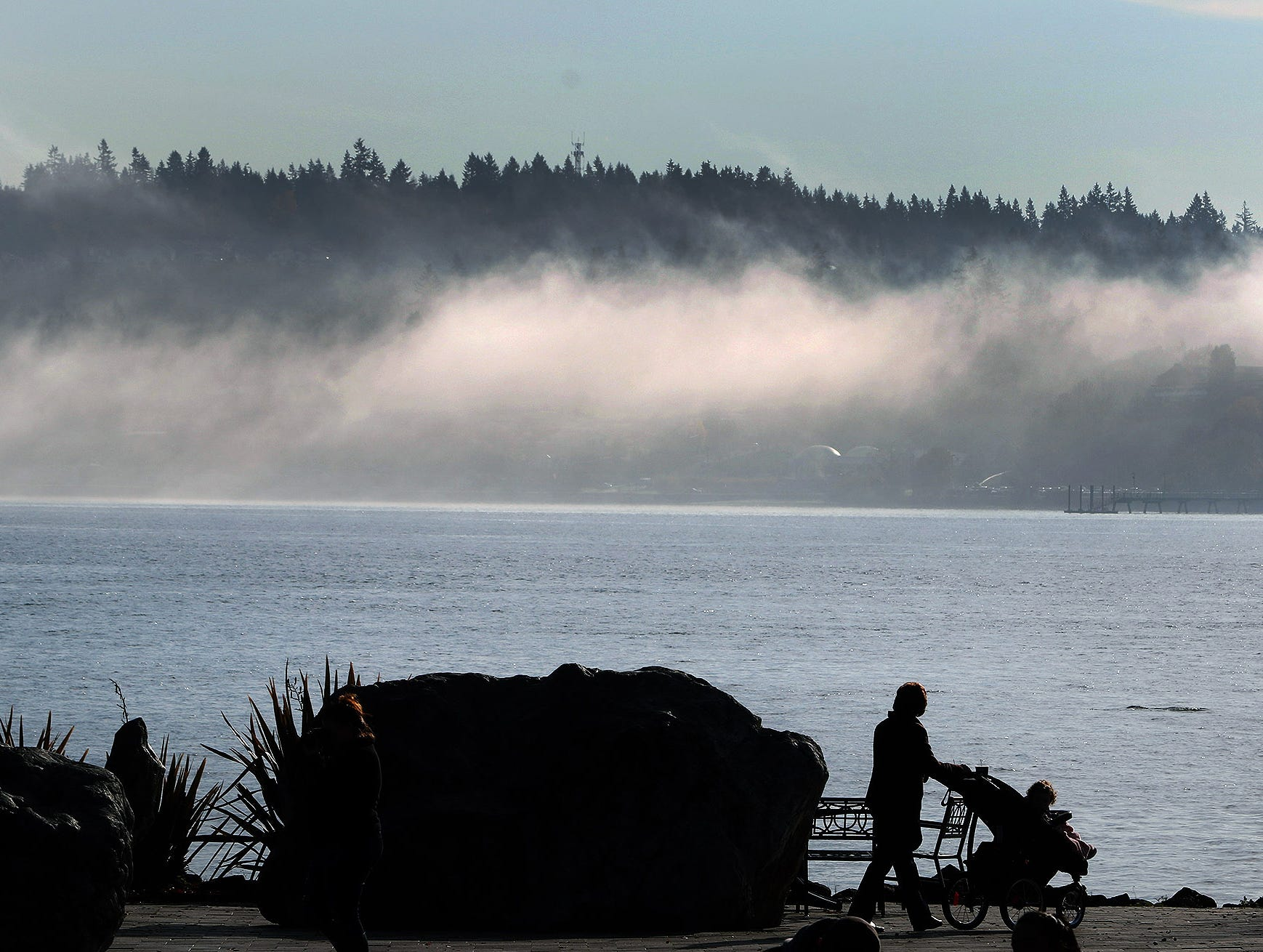 The morning fog burns off on Tuesday, November 20, 2018, from the Harborside Fountain Park in Bremerton.