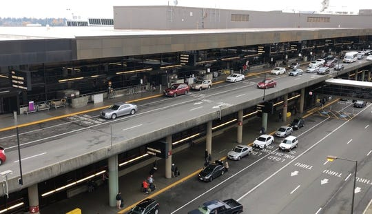 Drivers picking up and dropping off passengers at Seattle-Tacoma International Airport Friday.