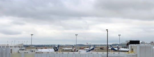 Planes take off and land at Seattle-Tacoma International Airport Friday.