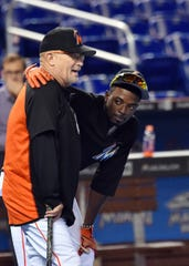 Perry Hill (left) and Dee Gordon during their days with the Miami Marlins. Hill was hired as the infield coach of the Mariners on Tuesday, reuniting him with Gordon.