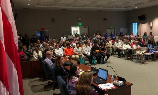More than 100 people filled the Cocoa City Council chambers for the swearing-in ceremony.