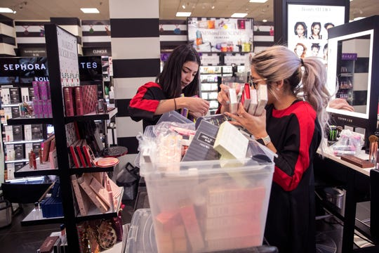 Gabriella Cantu (left) and Emily Beltran, product consultants for Sephora at JCPenney, stock items in preparation for Black Friday at the store in La Palmera mall on Tuesday, November 20, 2018. The store will open at 2 p.m. on Thanksgiving.