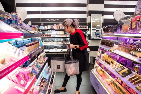 Emily Beltran, product consultant for Sephora at JCPenney, stocks items in preparation for Black Friday at the store in La Palmera mall on Tuesday, November 20, 2018. The store will open at 2 p.m. on Thanksgiving.