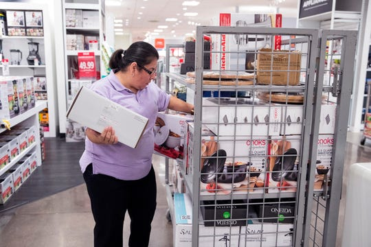 Gloria Pena, an associate at JCPenney, stocks items in preparation for Black Friday at the store in La Palmera mall on Tuesday, November 20, 2018. The store will open at 2 p.m. on Thanksgiving.