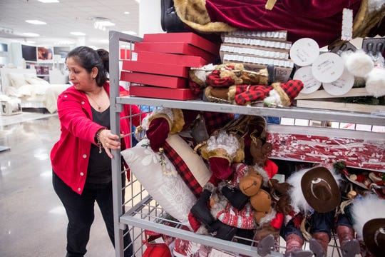 Irene Salcedo, a merchandizer at JCPenney, stocks Christmas items in preparation for Black Friday at the store in La Palmera mall on Tuesday, November 20, 2018. The store will open at 2 p.m. on Thanksgiving.