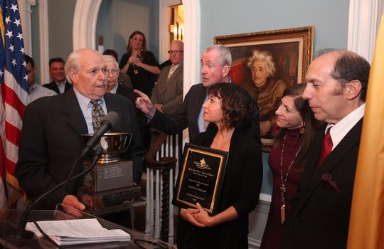 Lou Caracciolo of Amalthea Cellars receives the Governor's Cup for Best Red Wine at the New Jersey Wine Growers Awards at Drumthwacket in Princeton.