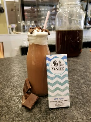 An adult chocolate milk paired with a small milk chocolate bar from MADE Atlantic City Chocolate Bar.