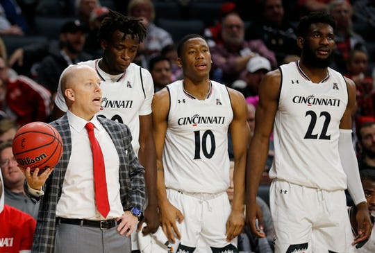 Cincinnati Bearcats head coach Mick Cronin grabs a loose ball on the sideline in the second half of the NCAA basketball game between the Cincinnati Bearcats and the Western Michigan Broncos at Fifth Third Arena in Cincinnati on Monday, Nov. 19, 2018. The Bearcats won 78-52 over the Mid-American Conference opponent.