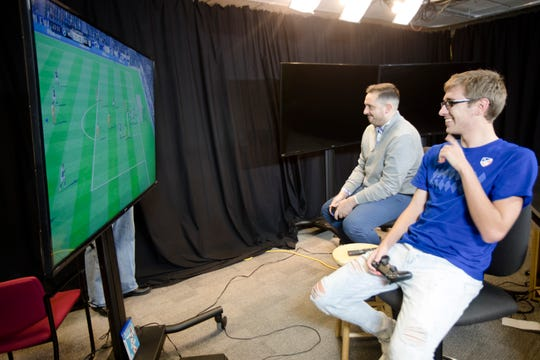"Gordon Thornberry ""GT Fiddle"", right, 21, FC Cincinnati eMLS player, plays FIFA with Patrick Brennan in The Enquirer office in Cincinnati, on Friday, Nov. 16, 2018."
