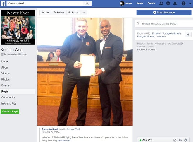 Keenan West, at right, being honored by Cincinnati City Council in 2014. The motivational speaker sued the city in March over a 2017 incident at his girlfriend's home, which initially was classified by police as an assault. West said the charges damaged his reputation and that he lost out on hundreds of thousands of dollars for speaking engagements because of news reports about it.
