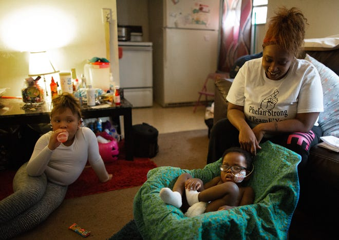 Danyelle Higgins talks about her son E'Yon Rankins, 2, at her home in the Westwood neighborhood of Cincinnati. Rankins was born with a genetic disorder, a deleted chromosome, rendering him mute and immobile.