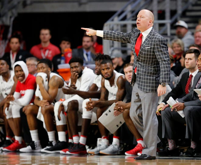 Cincinnati Bearcats head coach Mick Cronin shouts at an official in the first half of the NCAA basketball game between the Cincinnati Bearcats and the Western Michigan Broncos at Fifth Third Arena in Cincinnati on Monday, Nov. 19, 2018. The Bearcats led 43-29 at halftime.