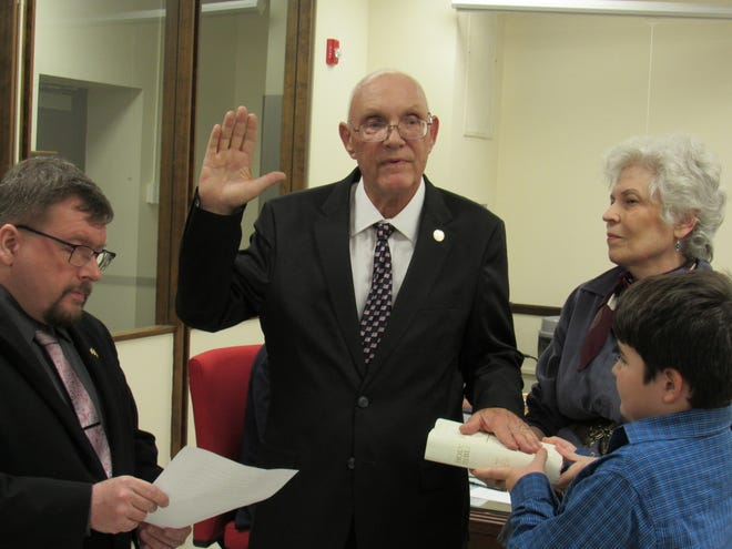 Dennis Sullivan is sworn in as mayor of Somerville by Somerset County Clerk Steve Peter with his wife Marge and grandson Adam holding the Bible.