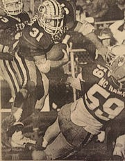 Tom Angelucci runs the ball for Madison Central