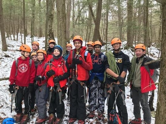 Members of Troop 850 prepare to scale a frozen waterfall in the Catskill Mountains in February 2018.