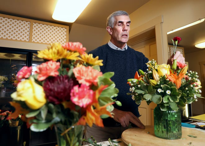 Ed Kiefer got into designing flower arrangements as a respite from the heat of his family's greenhouse, and has been working at Kiefer's Florist ever since.