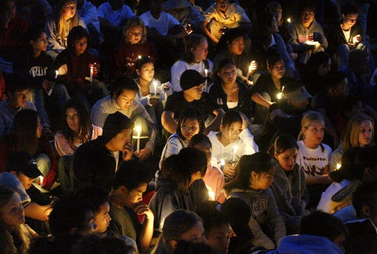 In this file photo, hundreds of students, family and friends gathered at the site of a fatal car accident for a memorial vigil in honor of the three boys from Lincoln High School who were killed in the crash.