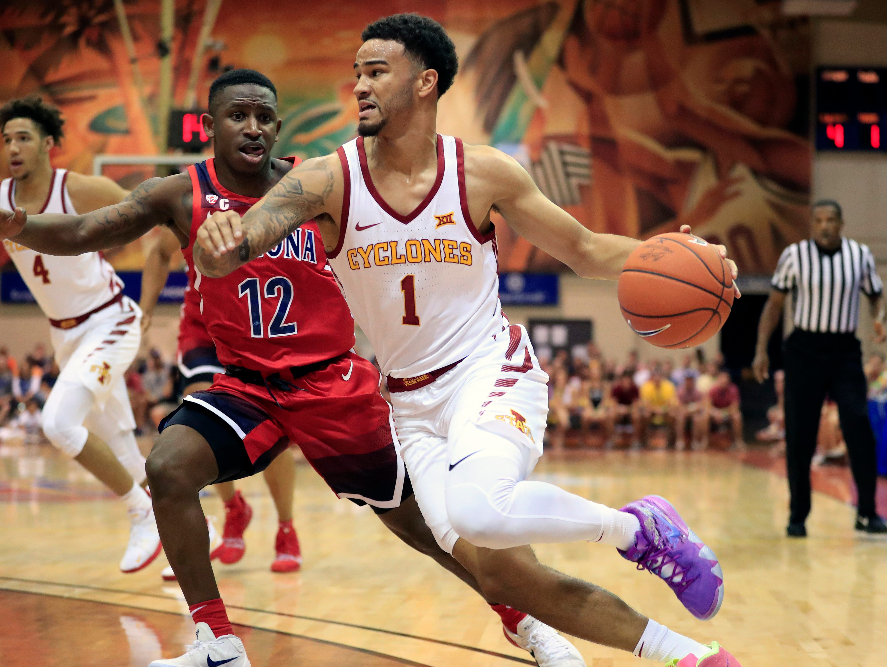 Iowa State guard Nick Weiler-Babb (1) dribbles around Arizona guard Justin Coleman (12) during the first half of an NCAA college basketball game at the Maui Invitational, Monday, Nov. 19, 2018, in Lahaina, Hawaii.