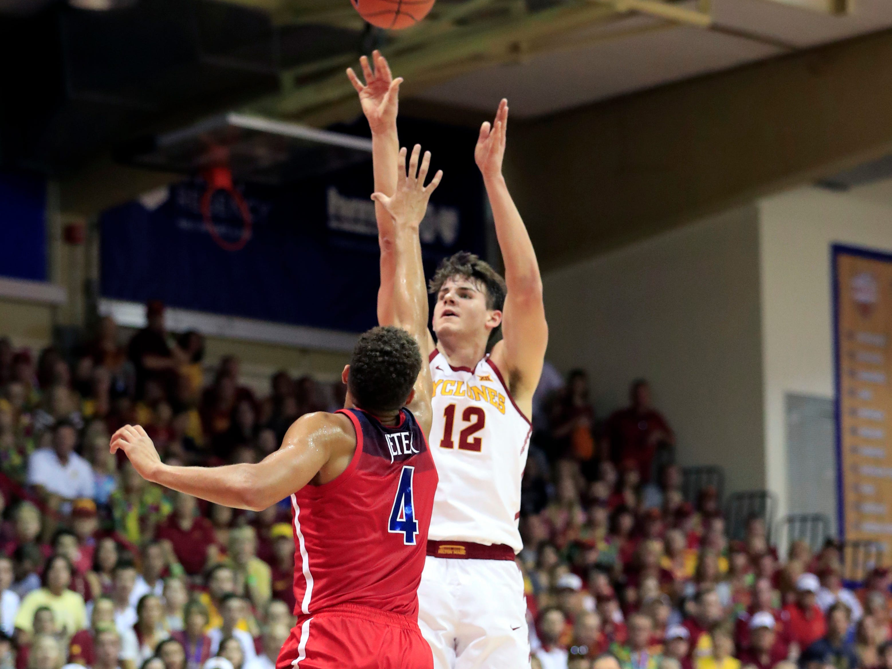 Iowa State forward Michael Jacobson (12) shoots over Arizona center Chase Jeter (4) during the first half of an NCAA college basketball game at the Maui Invitational, Monday, Nov. 19, 2018, in Lahaina, Hawaii. (AP Photo/Marco Garcia)