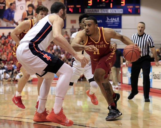 Iowa State guard Talen Horton-Tucker (11) tries to get past Illinois forward Giorgi Bezhanishvili (15) during the first half of an NCAA college basketball game at the Maui Invitational, Tuesday, Nov. 20, 2018, in Lahaina, Hawaii. (AP Photo/Marco Garcia)