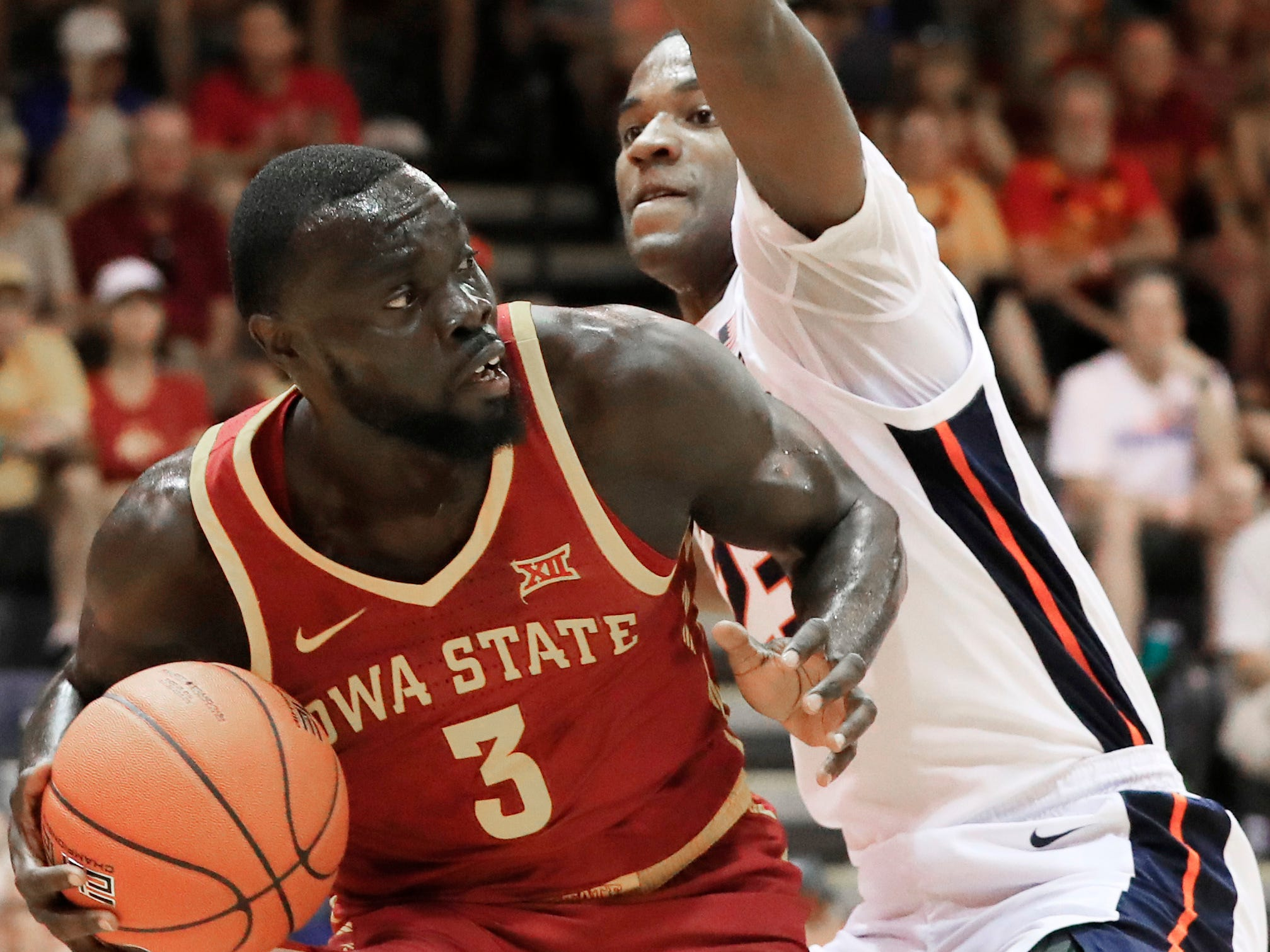 Iowa State guard Marial Shayok (3) tries to pass around Illinois guard Aaron Jordan (23) during the first half of an NCAA college basketball game at the Maui Invitational, Tuesday, Nov. 20, 2018, in Lahaina, Hawaii. (AP Photo/Marco Garcia)