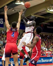 Iowa State guard Marial Shayok (3) shoots over Arizona center Chase Jeter (4) and guard Dylan Smith (3) during the first half of an NCAA college basketball game at the Maui Invitational, Monday, Nov. 19, 2018, in Lahaina, Hawaii.