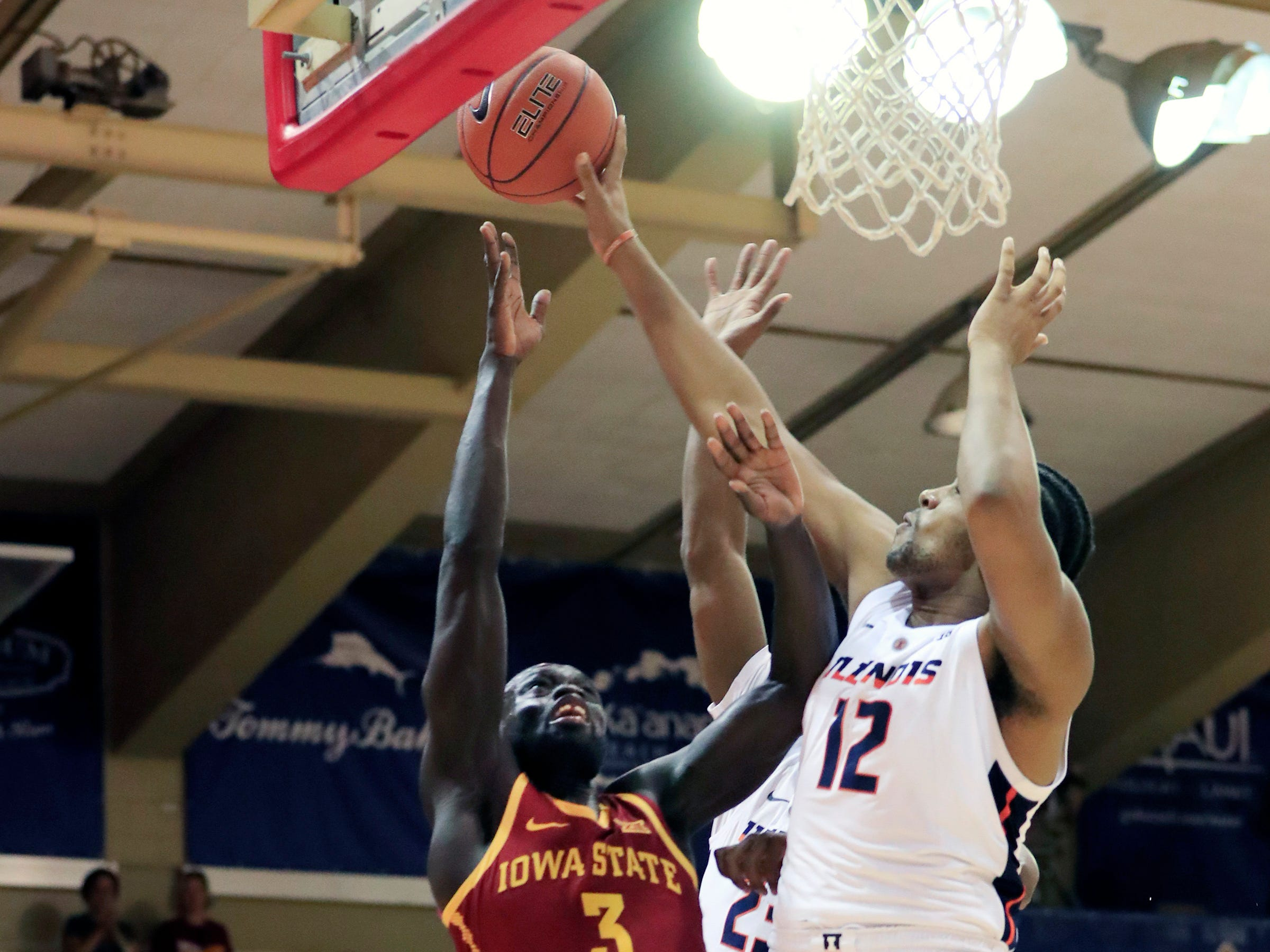 Illinois center Adonis De La Rosa (12) blocks a shot from Iowa State guard Marial Shayok (3) during the first half of an NCAA college basketball game at the Maui Invitational, Tuesday, Nov. 20, 2018, in Lahaina, Hawaii. (AP Photo/Marco Garcia)