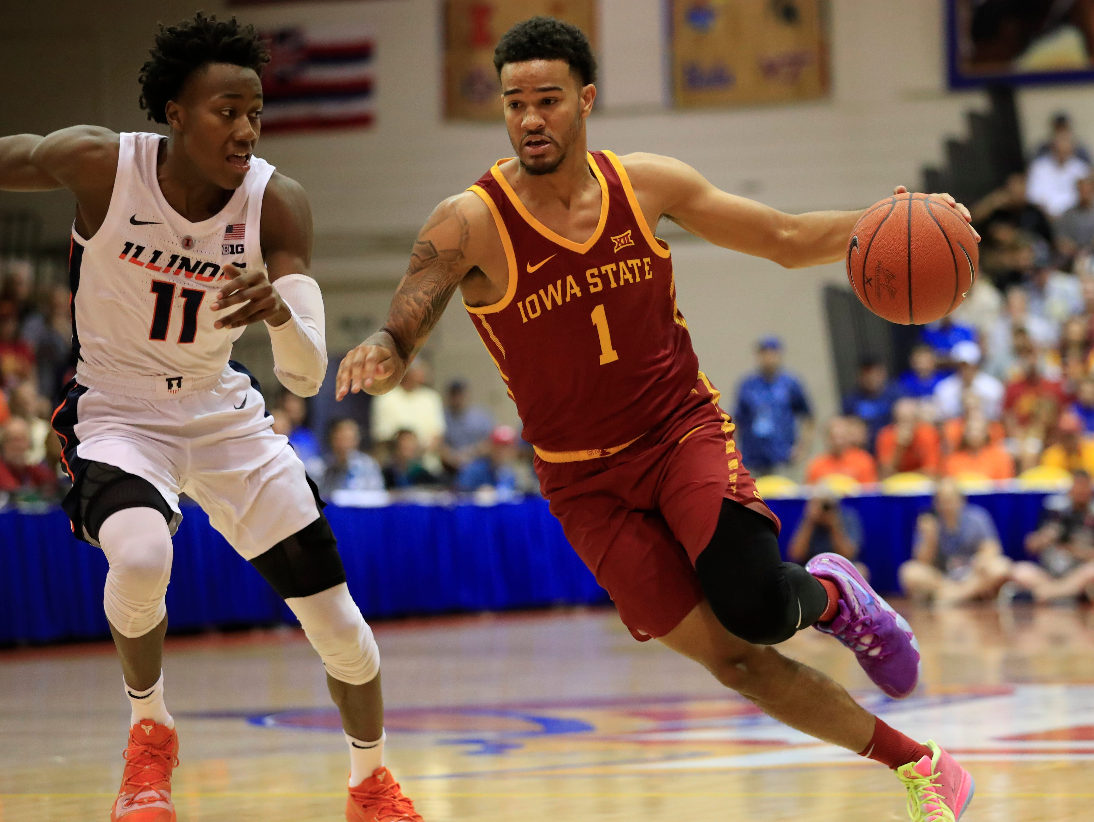 Iowa State guard Nick Weiler-Babb (1) drives past Illinois guard Ayo Dosunmu (11) during the first half of an NCAA college basketball game at the Maui Invitational, Tuesday, Nov. 20, 2018, in Lahaina, Hawaii. (AP Photo/Marco Garcia)