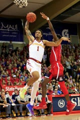 While being guarded by Arizona guard Brandon Randolph (5), Iowa State guard Nick Weiler-Babb (1) goes for a slam dunk during the first half of an NCAA college basketball game at the Maui Invitational, Monday, Nov. 19, 2018, in Lahaina, Hawaii.