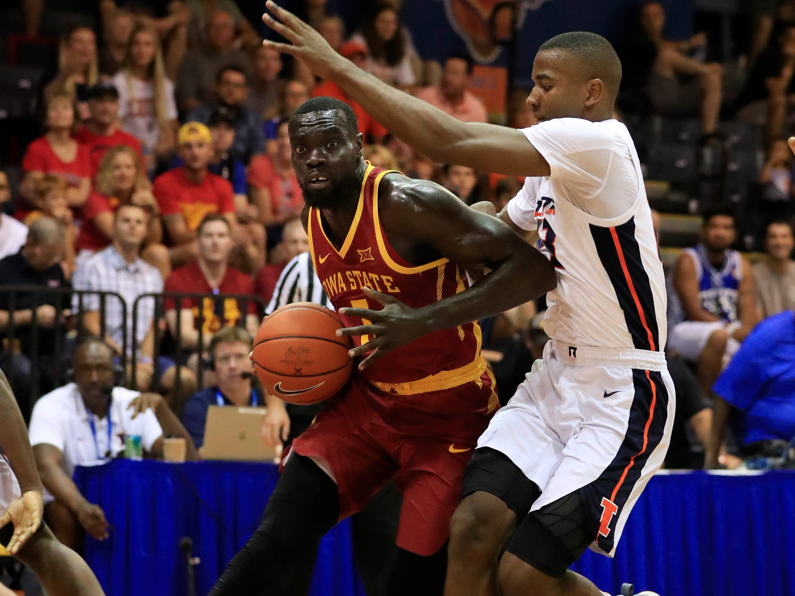 Iowa State guard Marial Shayok (3) tries to work himself past Illinois guard Aaron Jordan (23) during the first half of an NCAA college basketball game at the Maui Invitational, Tuesday, Nov. 20, 2018, in Lahaina, Hawaii. (AP Photo/Marco Garcia)