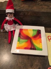 Adding hot water to skittles created a rainbow of colors for this Elf on the Shelf trick.
