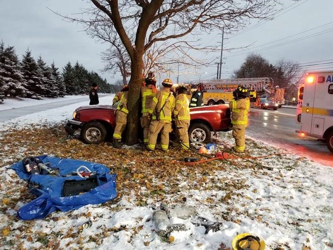 Firefighters work to free man from crash in Troy.