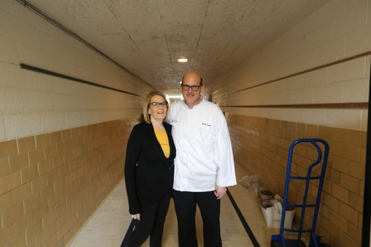 Rising Stars founders Deb and Mark Prentiss in the hallway of their multi-faceted educational facility for special needs students in Center Line.