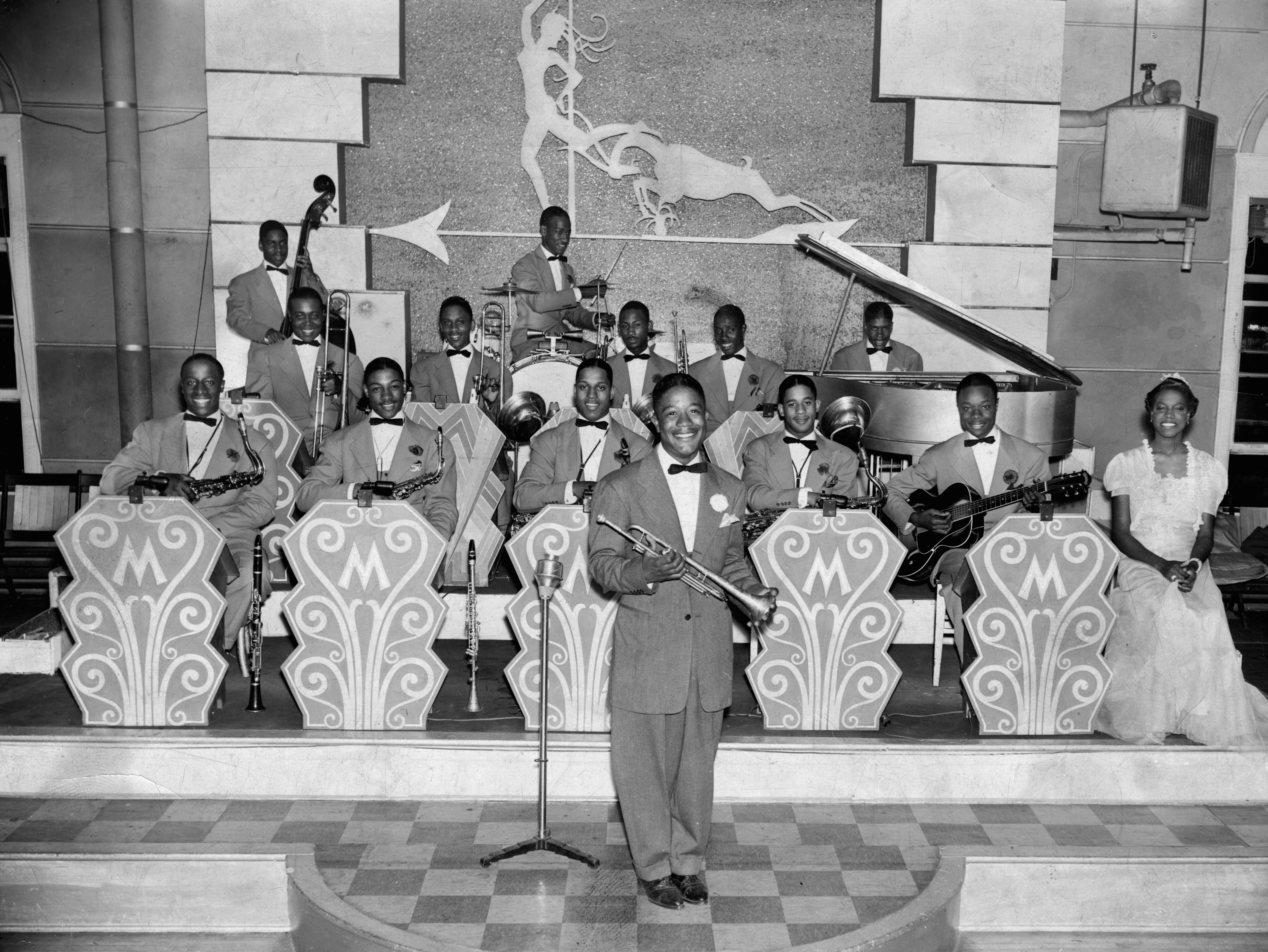 Mathew Rucker and his Spirits of Swing band, Mayfair Ballroom, circa 1938. Band members include: Walter Bragg, bass; Lawrence Hicks, drums; Willis Shorter, piano; Leroy Willis and Robert Lewis, trombones; Andrew Harkless and Edgar Williams, trumpets; Yusef Lateef, tenor sax; Frank Porter and Johnnie Taylor, alto sax; Alphonso Ford, tenor sax; George Gleaton, guitar; Priscilla Royster, vocals; Mathew Rucker, trumpet and leader.